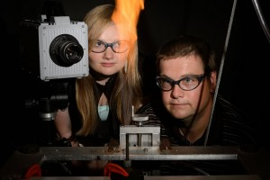Michael Renfro, Associate Professor of Mechanical Engineering, and Victoria Kallsen '15 (ENG) observe a flame experiment on June 26, 2013.