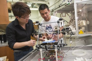 Chemical engineering student Derek Chhiv '14, right, discusses with Professor Anson Ma his group's prototype for an artificial kidney.