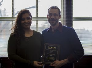 Pranjali Ichalkaranje presents plaque to awardee Nicholas Eddy.