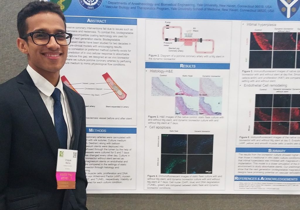 Vinayak Mishra presenting his work at the SACNAS conference.