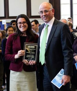 Lauren Cenci presents plaque to awardee Charles W. Mahoney.